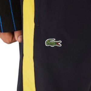 Pantalon déperlant Lacoste sport  marine/jaune